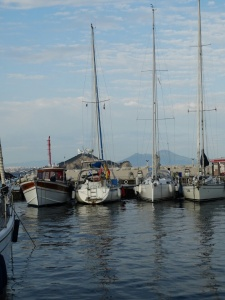 Procida marina. Vaila with Vesuvius in the distance.