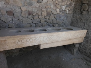 The measuringbtable, Pompei. Different sized holes for different stuff. Simple but effective.
